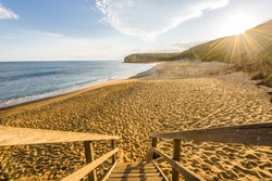 Bright sunny summer sunset sunrise coast view to wild Bass Strait sea, stairs lead you to empty sandy beach bay at Great Ocean Road, best surfing relaxing,Australia
