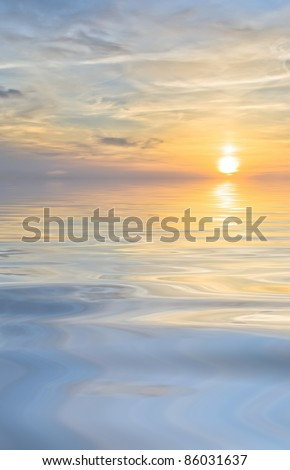 bright sunset and clouds at sea background