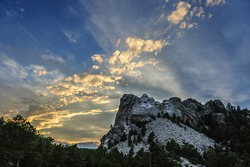 Bright Sunset colors behind Mount Rushmore National Monument