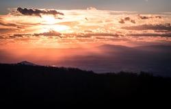 Bright sunset light fills the Shenandoah Valley during a Winter evening at Shenandoah National Park.