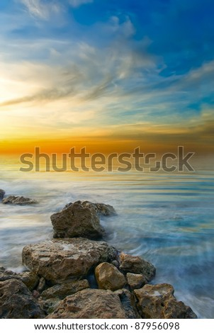 bright sunset sea and a calm sea