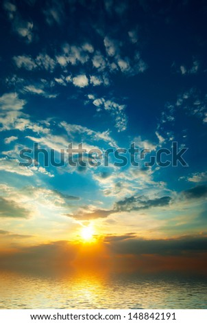 bright sunset with rays and clouds at sea background #148842191