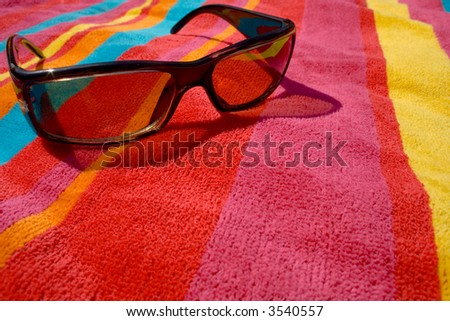 bright towel and sunglases