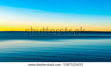 Bright Tranquil Seascape on Cape at Sunrise, Abstract Motion Blur Background