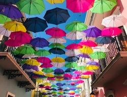 Bright Umbrellas handing above the street in Old San Juan Puerto Rico