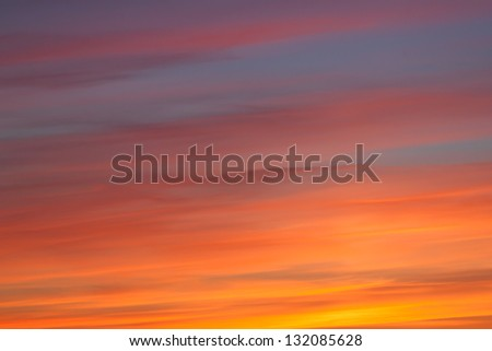 Bright vibrant orange and yellow colors sunset sky