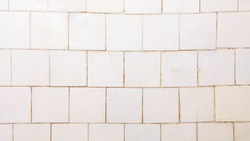 Bright vintage wall made of white plastic tiles.White or gray plastic wall and tile abstract background.