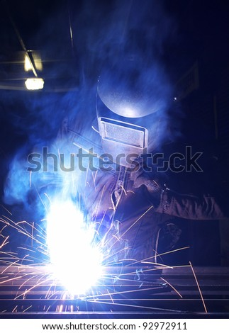 Bright welding and sparks. Construction and production
