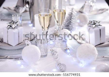 bright white and silver new year eve or christmas table in a luxury restaurant with champagne #516774931