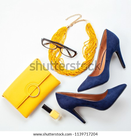 Bright yellow accessories and blue shoes for girls and women. Urban fashion, beauty and fashion blog concept #1139717204