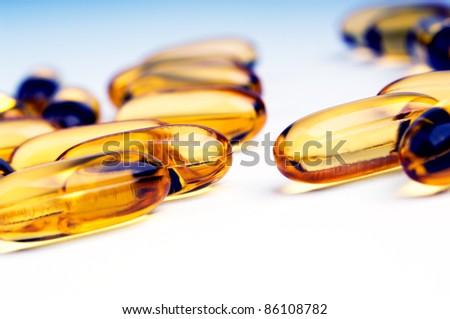Bright yellow capsules with shallow focus