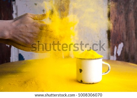 Bright yellow colour for Indian holi festival. Colorful gulal (powder color) for Happy Holi with copy space. #1008306070