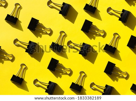bright yellow pattern with office supplies. Graphic background with clips stock photo