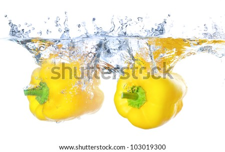 Bright yellow peppers in water. Tasty and healthy food