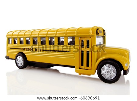 Bright yellow school bus arrives to transport children
