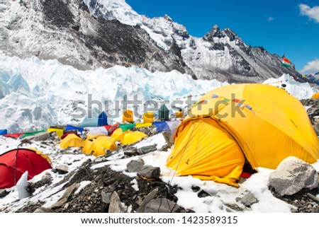 Bright yellow tents in Mount Everest base camp, Khumbu glacier and mountains, sagarmatha national park, trek to Everest base camp - Nepal Himalayas