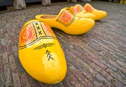 Bright yellow wooden clogs, tradistional Holland's shoes