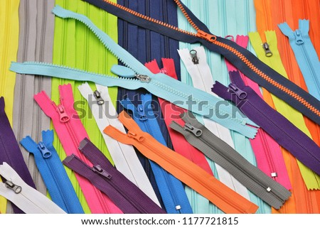 Photo of  Bright zipper of different colors and variants in the textile industry