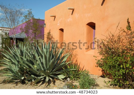 brightly colored adobe structures #48734023