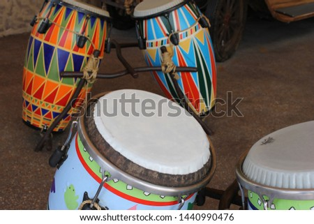 Brightly colored conga drum waiting to be played #1440990476