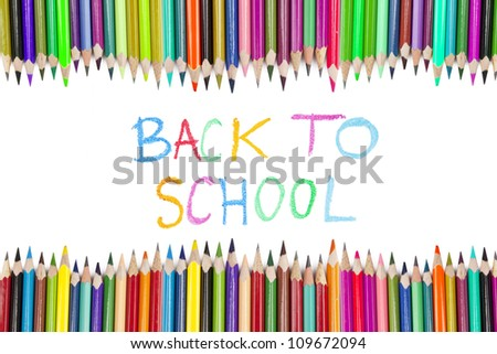 Brightly colored crayon border with text of back to school