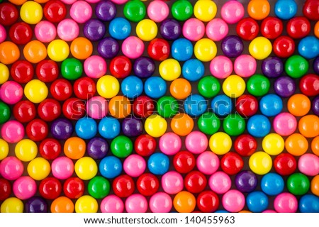 Brightly colored gum balls laying flat, background