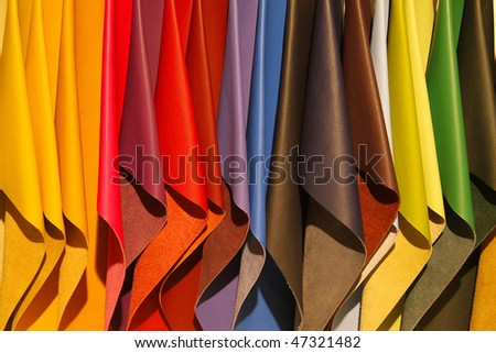Brightly colored leather samples - stock photo