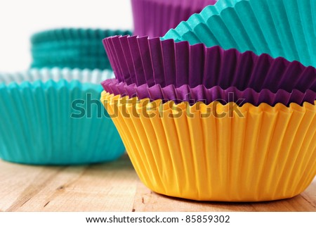 Brightly colored paper baking cups for cupcakes or muffins.  Macro with shallow dof.