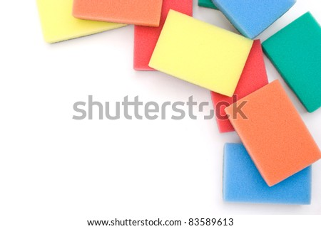 Brightly colored sponges on white background - stock photo