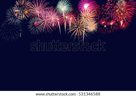 Brightly Colorful Fireworks on twilight background #531346588
