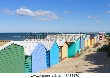 Brightly-coloured bathing boxes at Brighton Beach, Melbourne, Australia.  Viewed from behind, overlooking Port Phillip Bay.