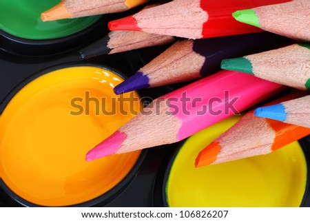 Brightly Coloured Paint and Pencils