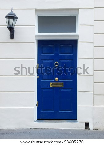 Brightly coloured traditional English house door in London - stock photo