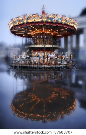 Brightly illuminated traditional carousel in Moscow. Russia