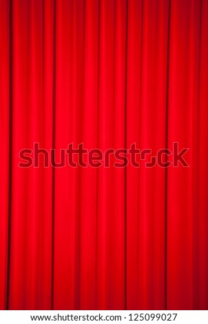 Brightly lit red curtains for background - stock photo