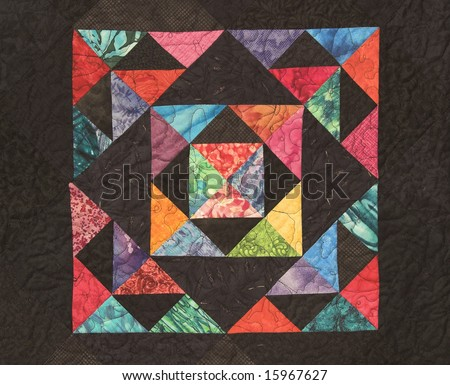 Brightly multicolored Quilt with black background