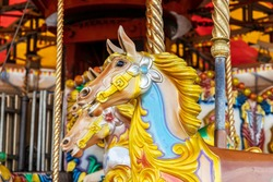 Brightly painted carousel pony at funfair.
