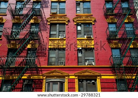 Brightly painted red and yellow building in Chinatown in New York City.