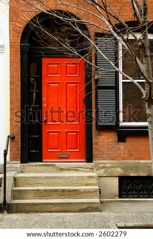 Brightly painted red front door.  Philadelphia, PA.