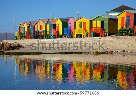 Brightly painted wooden bathing huts at St James Beach, near Cape Town, South Africa.