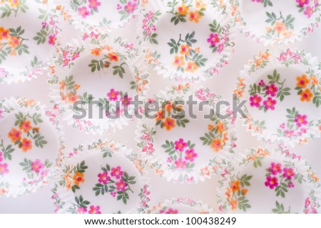 brightly paper with flower patter baking cups for cupcakes or muffins - top view