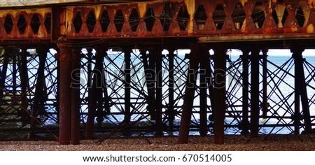 Brighton pier structure. Rusty pier structure #670514005