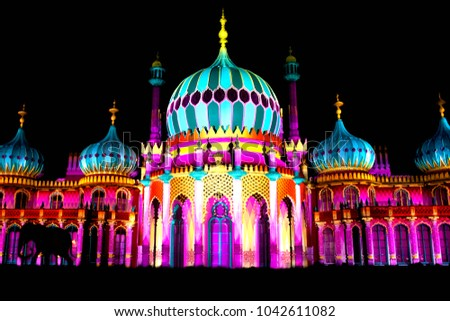Brighton's famous Royal Pavilion is lit up with amazing illuminations including the silhouettes of elephants in the Dr Blighty show performed during the Brighton art festival in England.