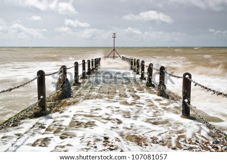 Brighton's Little Pier; A couple of hundred yards down the coast from Brighton's illustrious piers, a small stone pier is battered by the vicious waves of the English Channel.