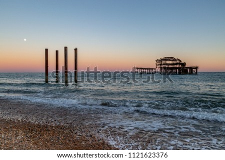 Brighton's West Pier silhouetted at sunset, on a summer's evening #1121623376