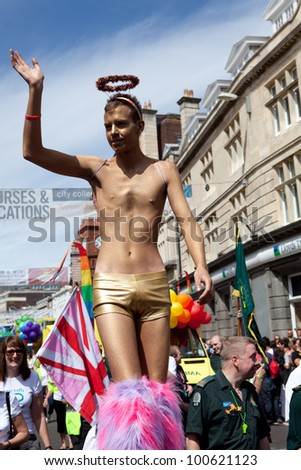 BRIGHTON, UK - AUG 13. The Golden Angel, a participant from the LGBT community join the pride parade at Brighton & Hove Pride Festival on August 13, 2011.