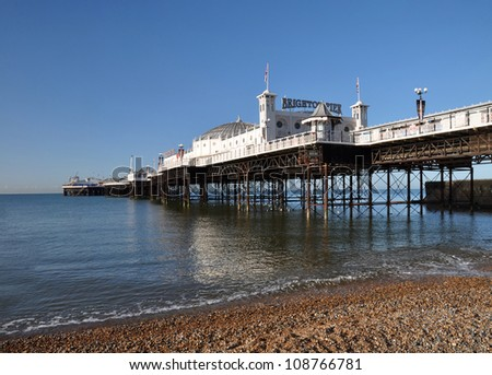 Brighton, United Kingdom -  a vertical panoramic view of the iconic and historic Brighton Pier on a beautiful Spring day with significant copy space available.