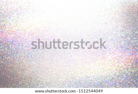 Brilliance crystals shimmer texture. Iridescent glitter. Spectral light flare on white background. Chistmas decorative blink surface.