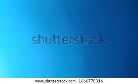 brilliant blurred center on sky blue background color, gradient radial blur design, black border