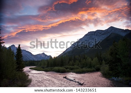 Brilliant clouds lit by the sunrise in the mountains